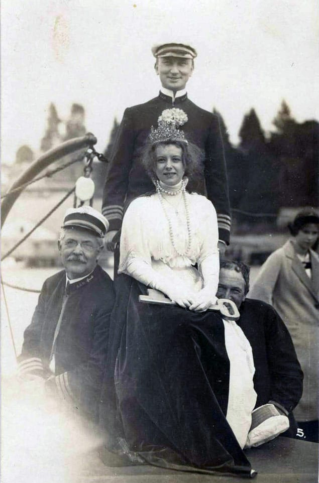 Unidentified Cathlamet Regatta queen and others, 1913. Another Woodfield photo taken at the same time (held by the Wahkiakum County Historical Society) is captioned: Cathlamet Regatta Queen and Admiral, 1913. Aboard flagship. #17, Woodfield Photo. Courtesy Cathlamet Blanche Bradley Public Library